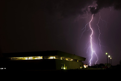 Single image of lightning striking north of the New Muon Laboratory at Fermilab; Summer 2011.  This photo shows a bolt of lightning striking the ground to the north of  the New Muon Laboratory.
