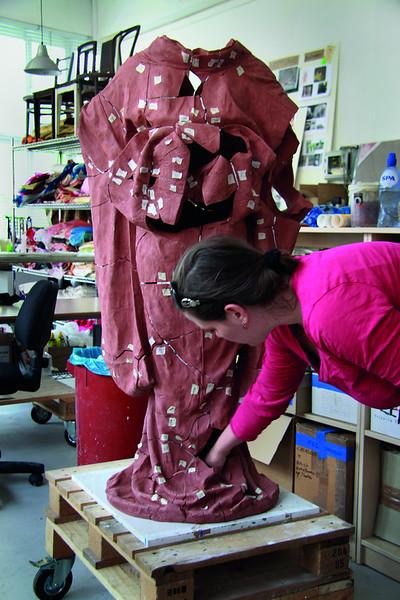 In the process of repairing a broken kimono sculpture using kintsugi, Japanese golden joinery