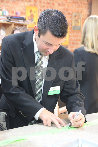 Pictured here is: Matt Johnson signing the ribbon from the ribbon cutting ceremony. Thursday, November 19, 2015, Studio Fusion had their ribbon cutting ceremony at Studio Fusion in Fort Dodge.