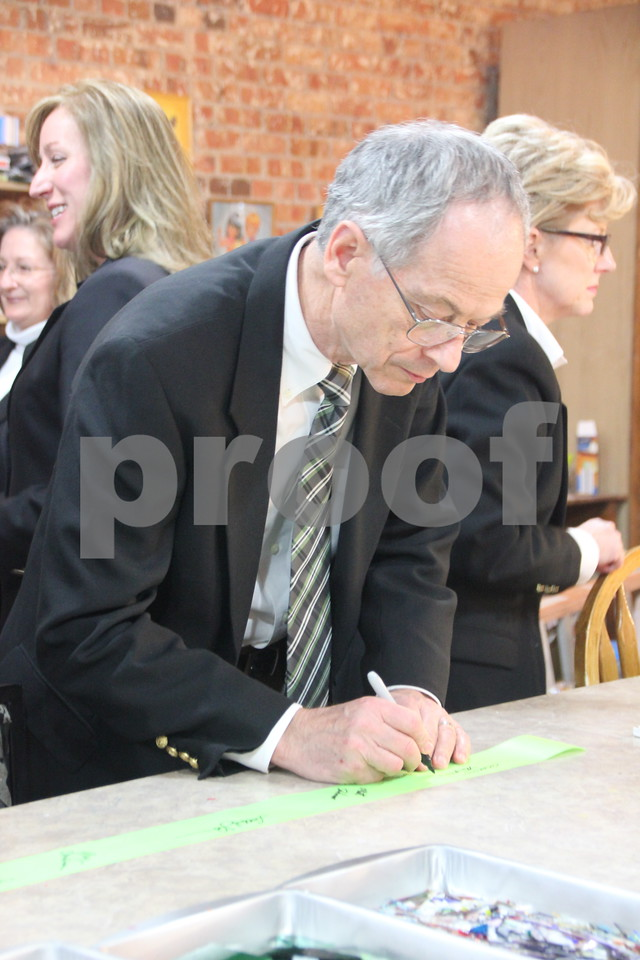Thursday, November 19, 2015, Studio Fusion had their ribbon cutting ceremony at Studio Fusion in Fort Dodge. Dean Barnett is seen here signing the ribbon from the ribbon cutting ceremony.