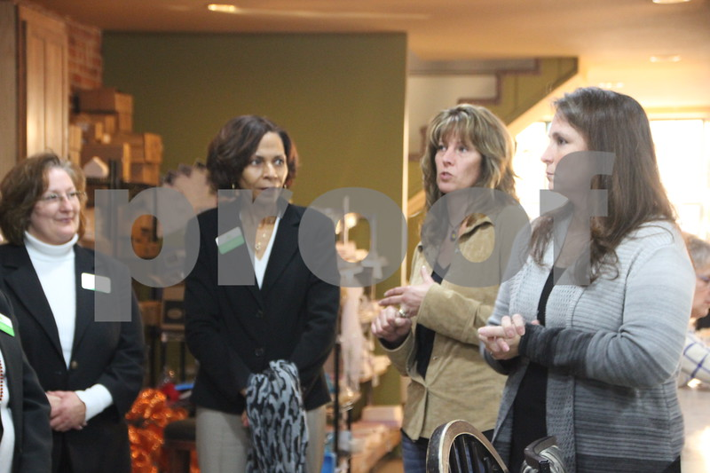 Thursday, November 19, 2015, Studio Fusion had their ribbon cutting ceremony at Studio Fusion in Fort Dodge. Pictured are (left to right): Ann Halbur, Clarice Thompson, co-owner Heather Applegate, Amy Wilson owner who are members of the Fort Dodge Growth Alliance.