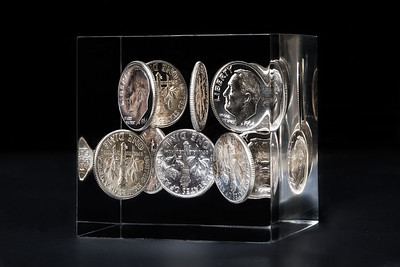 Dimes in Acrylic block.