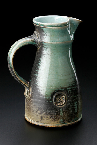 pitcher with impressed decoration