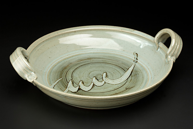 platter with handles and seashell sgraffito, celadon and slip