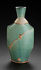 thrown and hand built bottle, matte green glaze, wax resist