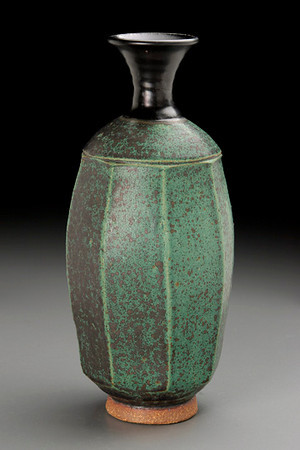 faceted bottle, turned foot, matte green glaze