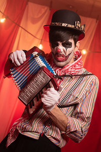 Goth clown with accordion
