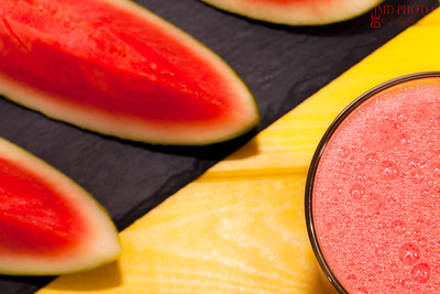 Frothy fruit smoothie. Refreshing healthy watermelon summer drink. Colorful vibrant close up.