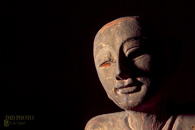 Traditional Aged Carving of a Buddhist Monk