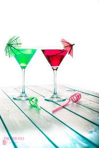 Summer fun alcoholic and non-alcoholic green and red fruit cocktail drinks.