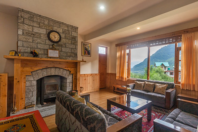 Drawing room on the ground floor of a classic home in the hills