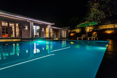 Pool side at night.