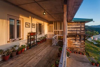 Golden hour moment at Thanedhar Estate porch