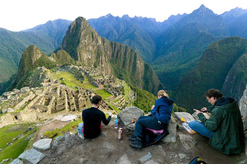 Tourists arrive at the crack of dawn to avoid the hordes of tour groups and to enjoy breakfast with a view of Machu Picchu at the Hut of the Caretaker of the Funerary Rock.