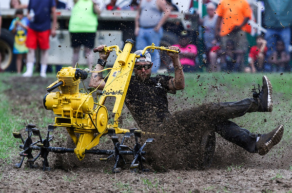 Wesley Houldridge of Three Creeks slips during the 2017 PurpleHull Pea Festival & World Championship Rotary Tiller Race in Emerson Saturday, June 24, 2017.
