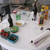 ingredients to bottle wine: snacks, beer, wine glasses to taste, oil to oil the corker machine, water