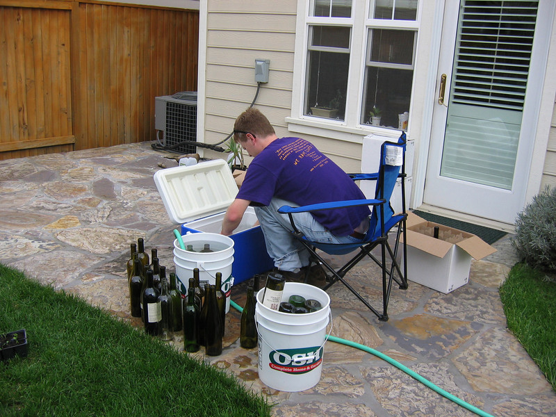 Paul sterilizing used wine bottles