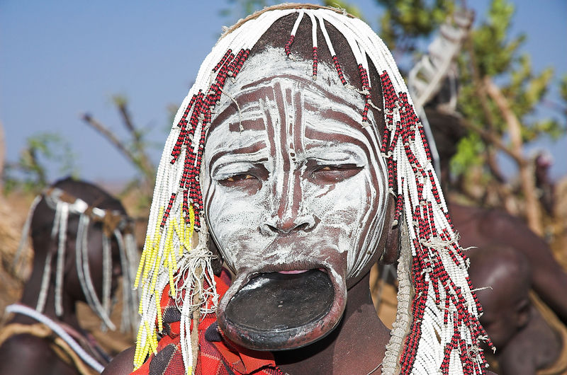 "Mursi woman with the traditional lip plate, Omo Valley.  <a href=""http://happytramp.smugmug.com/gallery/1449802"">Click here for a short slide show on the Mursi</a>."