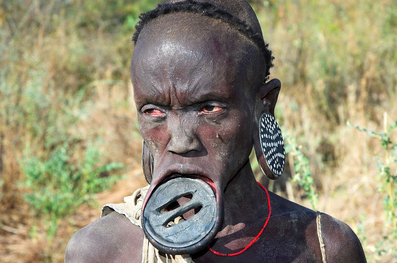 Mursi woman with the traditional lip plate, Omo Valley.