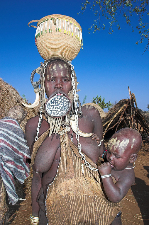 "Mursi woman with the traditional lip plate, and her child, Omo Valley.  <a href=""http://happytramp.smugmug.com/gallery/1449802"">Click here for a short slide show on the Mursi</a>."