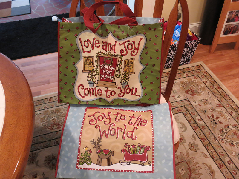 Reusable totes - one side says Love and Joy come to You and the other side says Joy to the World - 2 for me and 2 for Jules