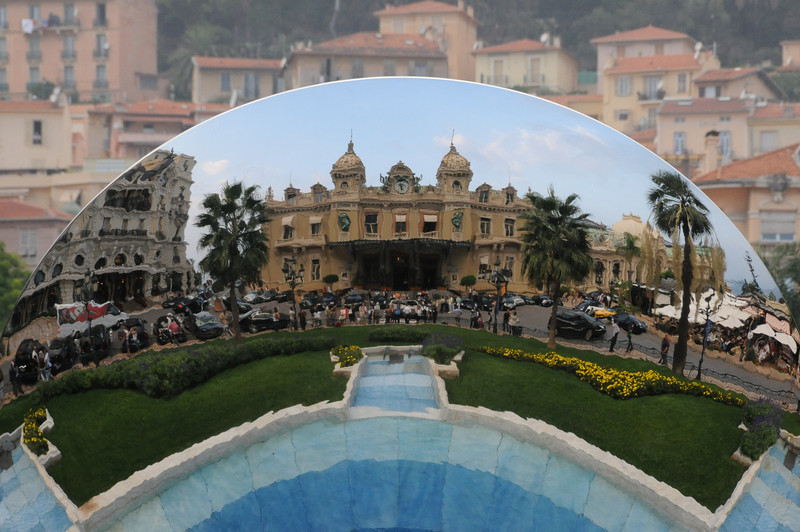 The casino reflected in a mirror <br /> This is a great big mirror with water running down it into a pool. It's sat, as you can see, directly opposite the Monte Carlo Casino and so gives excellent reflection views.<br /> <br /> This shot came 14th out of 47 in a competition among the photographers in the bank I am contracting for at the moment, in December 2008. It was competition to submit your best snaps of 2008.