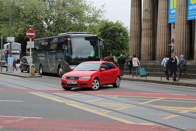 My pic of the coach spectacularly blocked by a car which shouldn't be there in the first place making an illegal right turn....