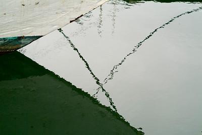 Dock Lines: reflections at Westport, Washington.