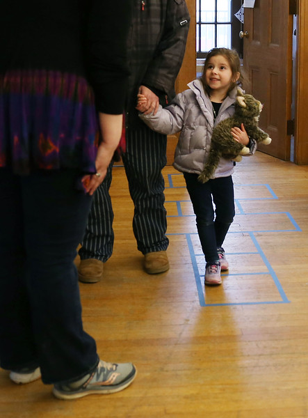 HOLLY PELCZYNSKI - BENNINGTON BANNER Tristin DeLucka, 4 years old of Hoosick Falls NY drops off her stuffed kitten, Rosie to the John G. McCullough Free Library for a sleepover event on Friday afternoon.
