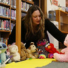 HOLLY PELCZYNSKI - BENNINGTON BANNER Katrina Hastings,<br /> Children's Librarian at The John G. McCullough Free Library arranges stuffed animals during a stuffed animal sleepover event . Children leave their stuffed animals at during open hours on Friday and pick them up the next morning at Powers Market.
