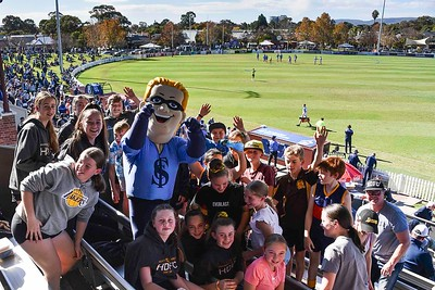 Bluey moves among his people