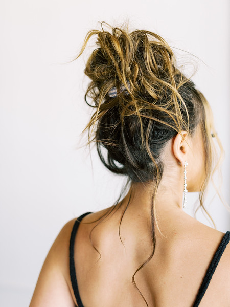casual messy bun top knot updo look for long hair with scrunchy - RUBY FINCH - Las Vegas hair and makeup artists - KRISTEN KAY PHOTOGRAPHY - Las Vegas Elopement Photographer - #simplehairstyles #bridal #updo #messybun #topknot