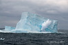 Large-iceberg-with-breaking-wave,-Elephant-Island,-South-Shetland-Islands