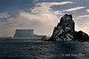 Tabular-iceberg-and-rocks,-Elephant-Island,-South-Shetland-Islands
