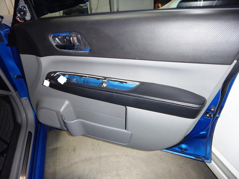 Door trim and switch bezel removed.