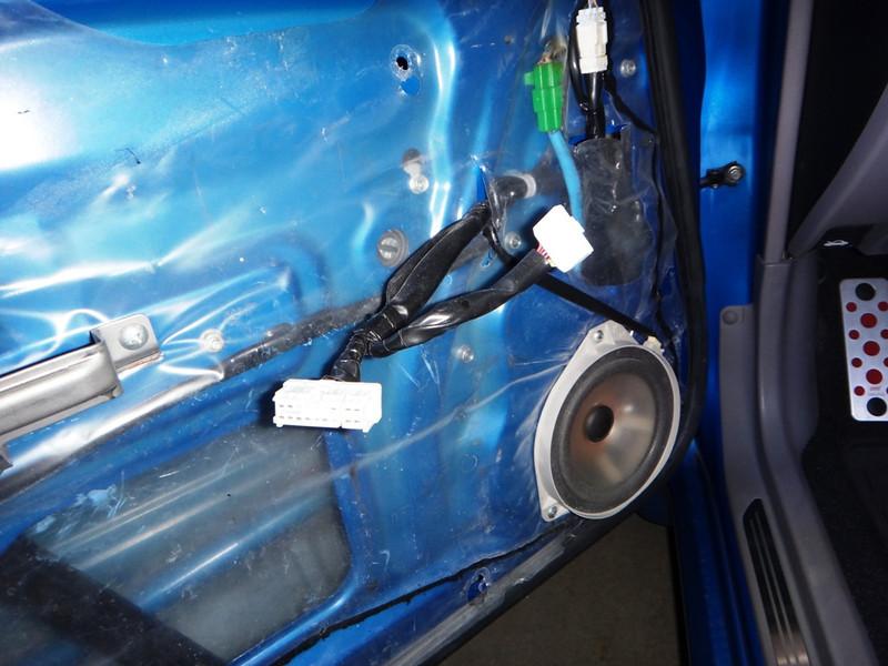 Door panel removed to expose factory speaker.