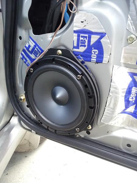 "Aftermarket speaker and speaker adaptor ring  from  <a href=""http://www.car-speaker-adapters.com/items.php?id=SAK065""> Car-Speaker-Adapters.com</a>   installed on door"