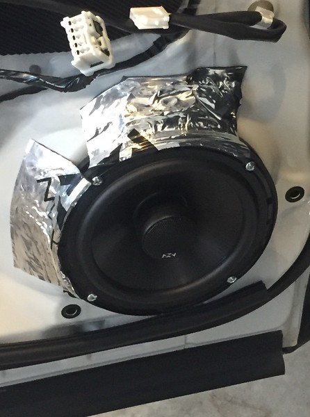 "Aftermarket speaker and speaker ring  from  <a href=""http://car-speaker-adapters.com/items.php?id=SAK065""> Car-Speaker-Adapters.com</a>   installed on door.  Sound deadener installed."