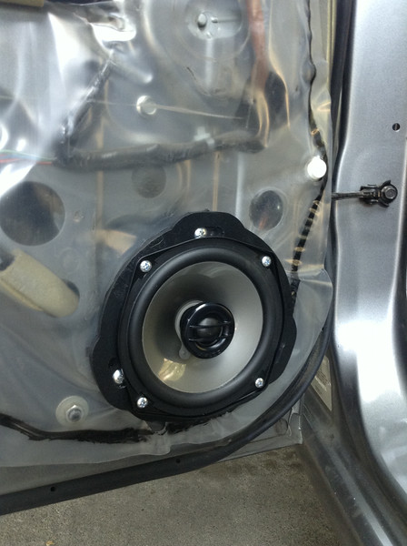 """Aftermarket speaker and speaker adapter ring  from  <a href=""""http://www.car-speaker-adapters.com/items.php?id=SAK040""""> Car-Speaker-Adapters.com</a>   installed on door"""