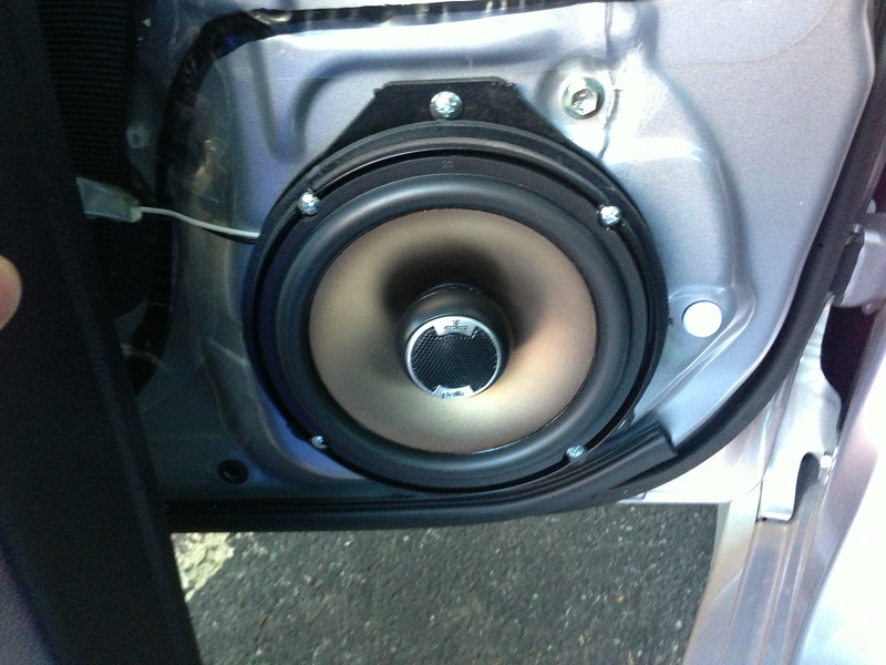 """Aftermarket speaker and speaker adapter ring   from  <a href=""""http://www.car-speaker-adapters.com/items.php?id=SAK065""""> Car-Speaker-Adapters.com</a>   installed on door."""