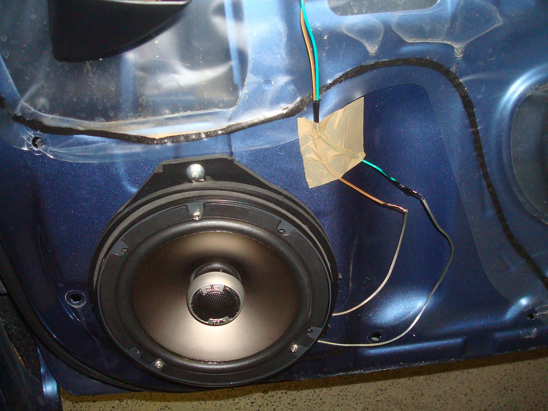 """Aftermarket speaker and speaker adapter from  <a href=""""http://www.car-speaker-adapters.com/items.php?id=SAK065""""> Car-Speaker-Adapters.com</a>  installed"""
