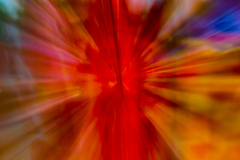 Zooming reds and oranges give a feeling of action and speed in an abstract photo of blown glass.