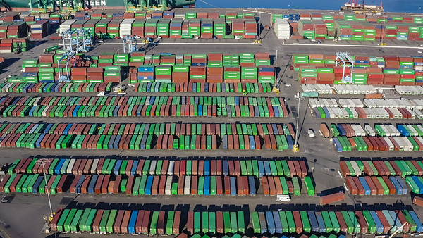 Rows and columns of shipping containers waiting to be loaded aboard an Evergreen ship bound for Asia - San Pedro, Los Angeles, California, United States (US)