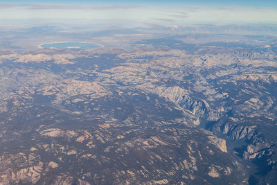 Aerial view of rocky mountain landscape with lake