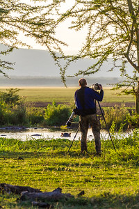 Man taking photograph of hippopotamus - East Africa - Tanzania