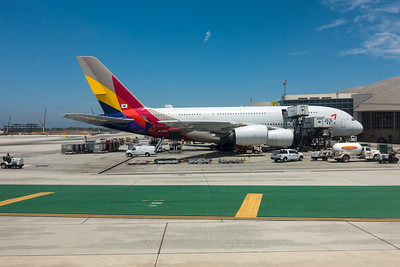An Asiana Airlines Airbus A380 sits at the Bradley International Terminal of Los Angeles International Airport (LAX) while cargo is loaded