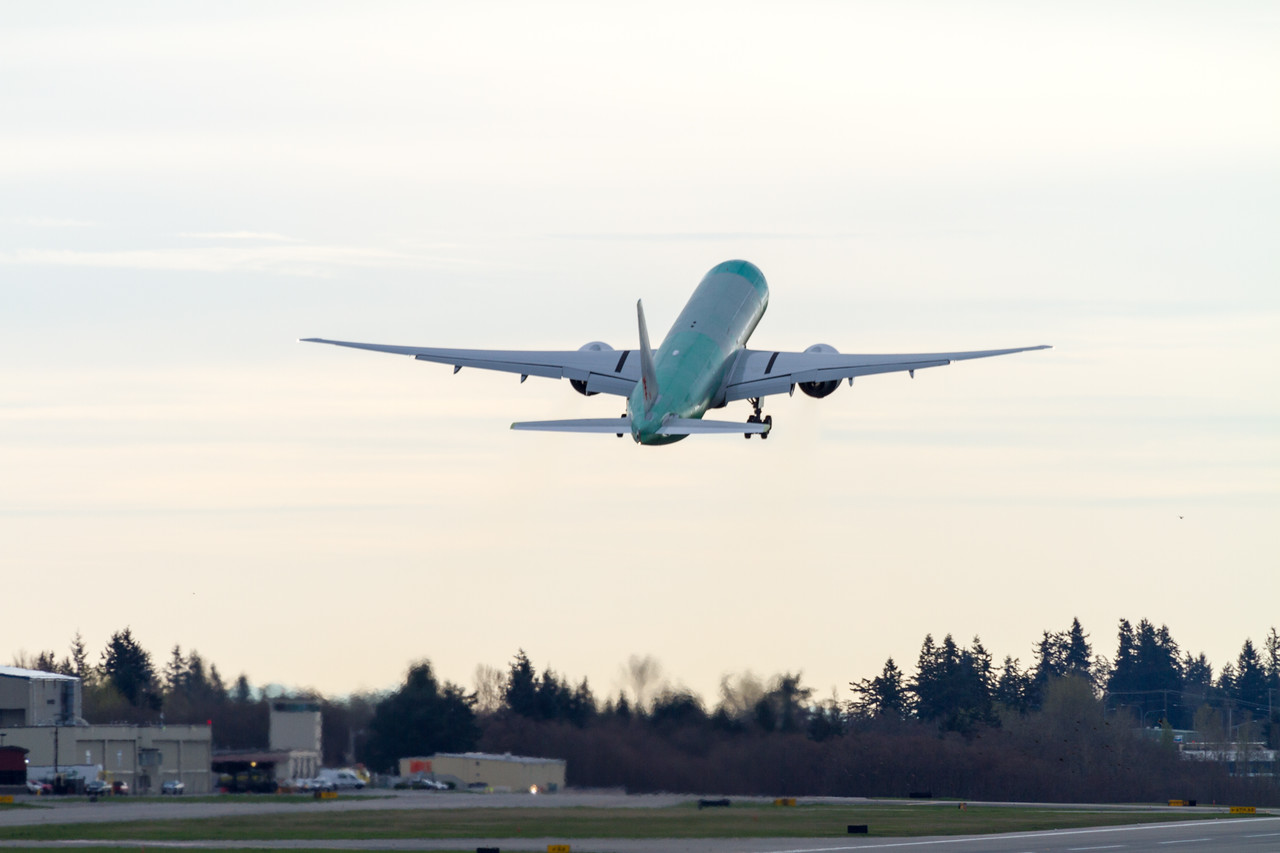 An unpainted Boeing 777 takes off from Paine Field in Everett - Washington on test flights