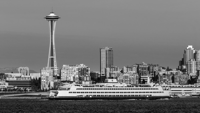 A Washington State Ferry crosses in front of the iconic Space Needle on Elliott Bay in Seattle
