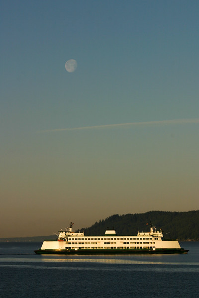 The Washington State Ferry Cathlamet crosses Puget Sound to Whidbey Island under a full moon.