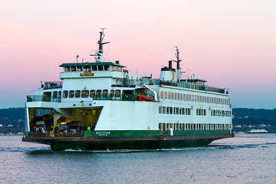 The MV Kittitas arrives in Mukilteo while another ferry boat can be seen behind it in Clinton, Washington